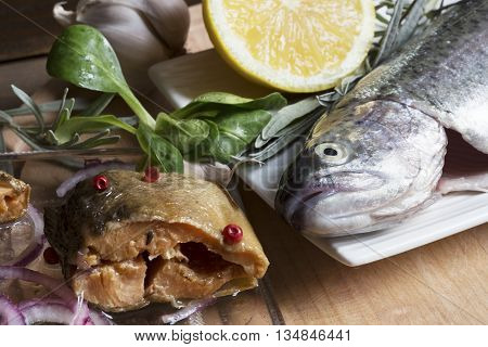 Raw trout and the smoked marinated trout fillet with vegetables