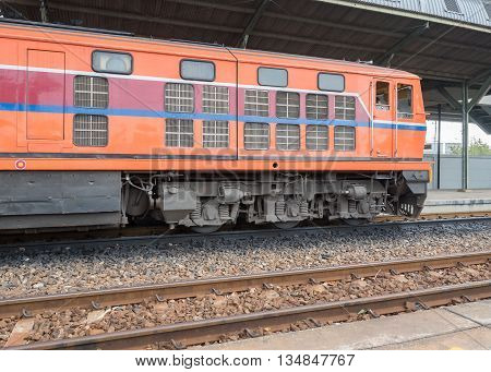 Red orange train Diesel locomotive on railway station