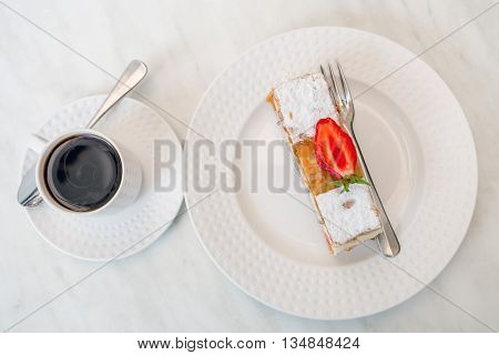 Coffee and cake with strawberry on white background