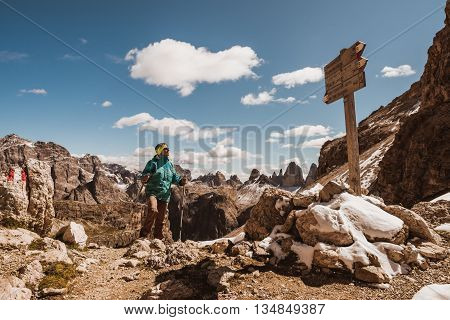 Hiker enjoying view from top of mountain Dolomites Italy