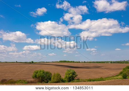 Beautiful view of untilled fields and beautiful cloudy sky