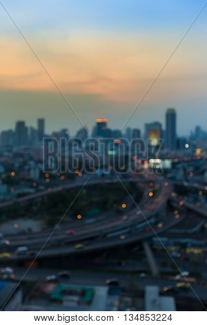 Abstract blurred lights, city downtown background and highway interchanged after sunset