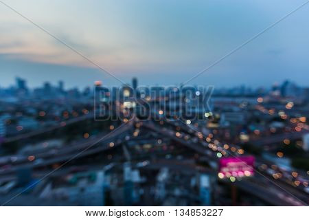 Blurred lights, city downtown background and highway interchanged after sunset