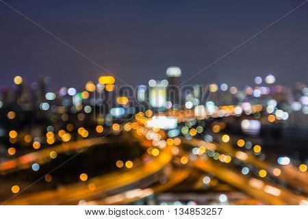 Night blurred lights, city road interchanged and office building background