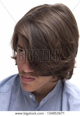Portrait Of Teen Boy With Long Surfer Haircut
