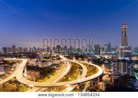 Before sunrise over highway road long exposure and city residence downtown background