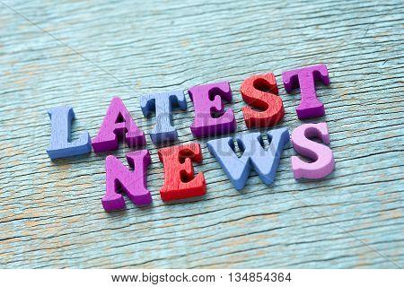 Latest News Phrase On Vintage Wooden Background