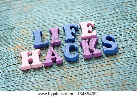 Life Hacks Phrase On Vintage Wooden Background