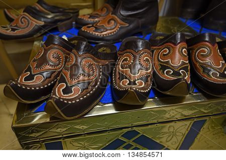 Colorful oriental ethnic shoes on flea market