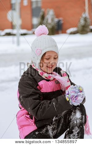 Small Girl Playing With Snow On Sunny Day.