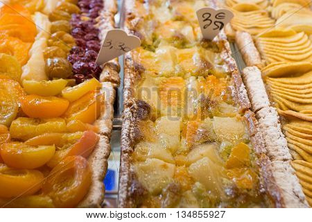 Variety of fruit pies in confectionary shop