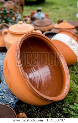 Large ceramic pot. Clay dishes. Large ceramic pot outdoors. Exhibition of ceramic tableware.