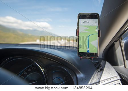 Phetchabun Thailand - January 2 2016: Photo of an iphone6 with google maps in the car