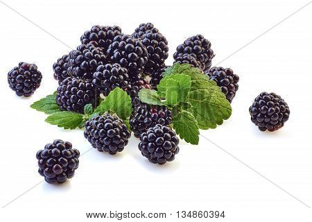 Heap of blackberries with mint leaves isolated on white background