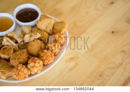 Many savour snack with sauce in white dish