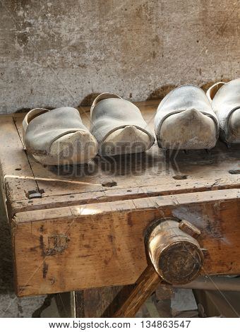 Wooden Soled Type Dutch Clogs And A Wooden Vise