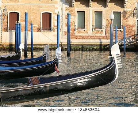 Venetian Gondolas Sailing The Waters Of The Grand Canal In Venice