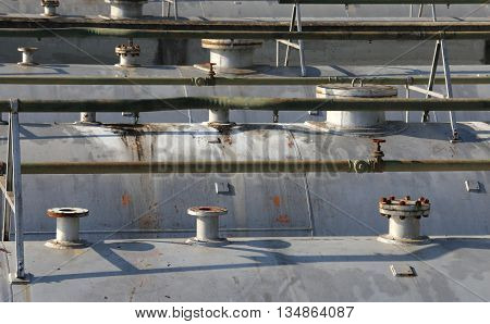Large Pipes And Safety Valve Over The Big Pressure Vessel
