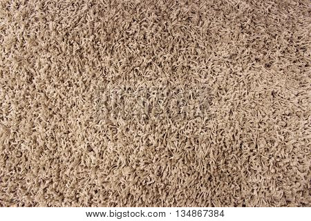 Fragment of material background a brown carpet
