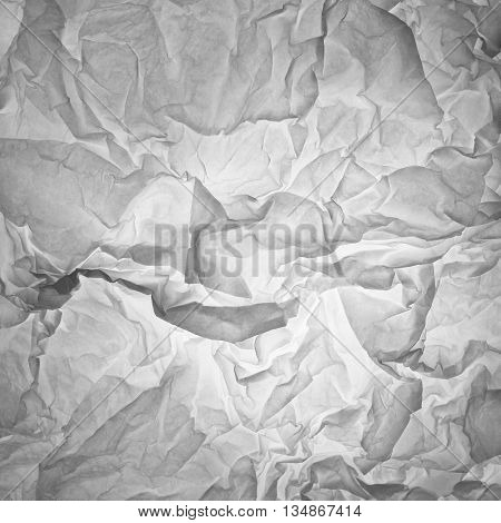 very crumpled paper, illuminated by soft light