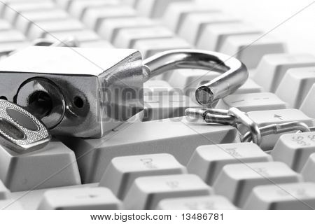 Computer  keyboard secured with chain and padlock