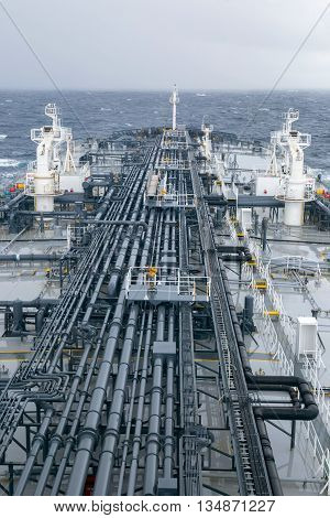 Oil tanker deck with pipeline in the sea.