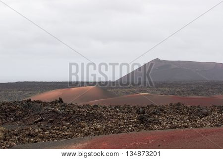 Desert arid stone volcanic landscape in Lanzarote, Canary Islands