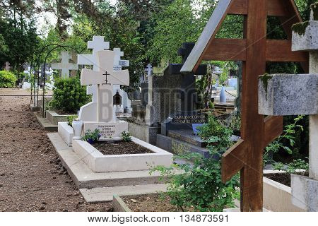 SAINT-GENEVIEVE-DE-BOIS, FRANCE - MAY 16, 2015: Cemetery St. Genevieve de Bois is the burial place of Russian immigrants.This is tomb of Russian writer Ivan Bunin