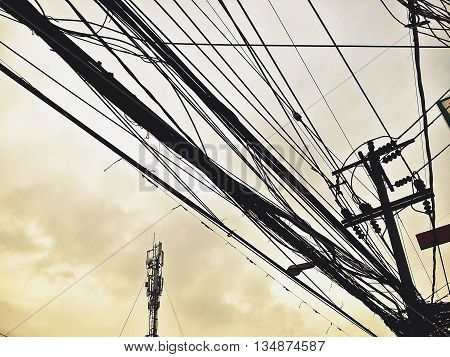 Style power lines and communication lines in the downtown clutter in retro colour mode