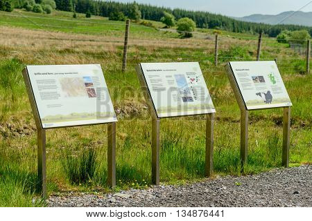 ABERFELDY SCOTLAND - JUNE 06 2016: Interpretation boards at entrance to Griffin Wind Farm near Aberfeldy in Perthshire Scotland.