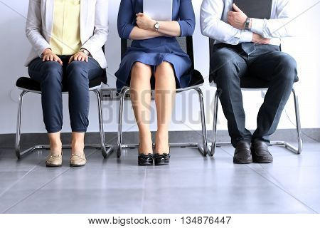 Business people waiting for job interview. Stress