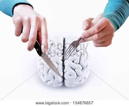 man with a knife and fork cutting brain