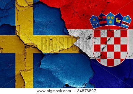 Flags Of Sweden And Croatia Painted On Cracked Wall