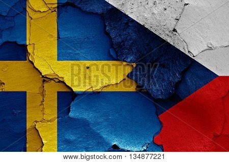 Flags Of Sweden And Czechia Painted On Cracked Wall