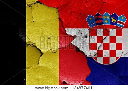 Flags Of Belgium And Croatia Painted On Cracked Wall