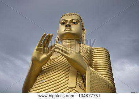 Buddha statue, cloudy day. Dambulla, Sri Lanka