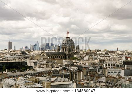 Panoramic view of Paris. Roofs of houses Saint-Augustin and the skyscrapers of La Defense