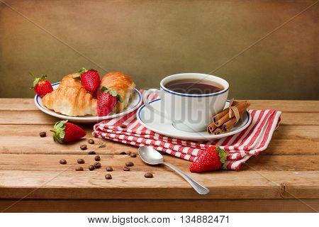 Beautiful breakfast arrangement with coffee on wooden table
