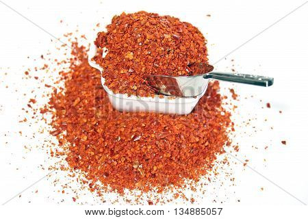 Crushed red chilli pepper, on white background