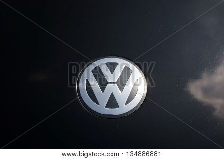 TURIN, ITALY - JUNE 9, 2016: Volkswagen logo on a black car body