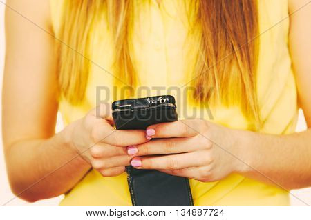 Equipment digital devices and people concept. Young woman using cell phone.