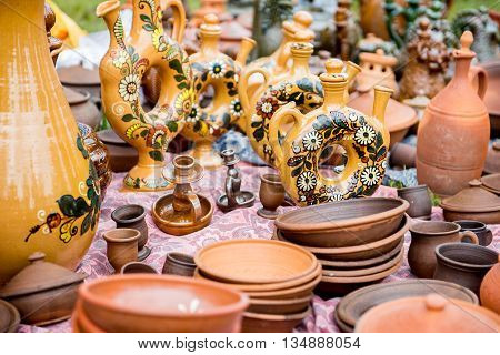 Ceramic pan. Clay dishes. Large ceramic pot outdoors. Exhibition of ceramic tableware. Ceramic ware handmade.