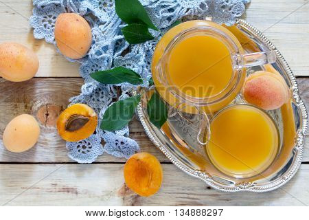A Refreshing Summer Drink With Peach In A Jug And Glasses On A Wooden Table, Top View.