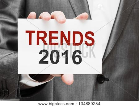 Trends 2016. Card with text in male hand
