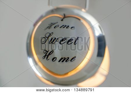 Crystal ball showing reflection of a Home Sweet Home candle holder
