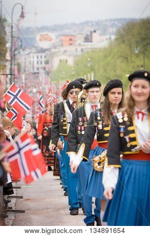 Oslo Norway - May 17 2010: National day in Norway. Norwegians at traditional celebration and parade on Karl Johans Gate street.