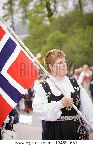 Oslo Norway - May 17 2010: National day in Norway. Norwegian woman in the national costume at traditional celebration and parade on Karl Johans Gate street.