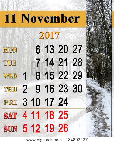 calendar for November 2017 with forest road with puddles and snow. Calendar for next November with cold Autumn pools