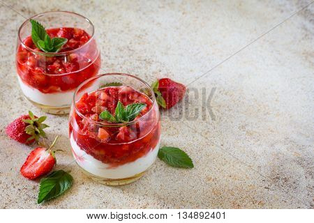 Layered Dessert With Strawberries, Mascarpone And Strawberry Jelly On Brown Stone Background. Place