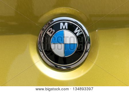 TURIN, ITALY - JUNE 9, 2016: BMW logo on a yellow car body